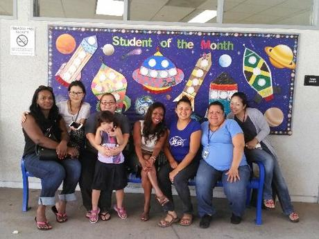 Principal Creary with PTA and Parent Volunteers in front of our new Student of  the Month Board!